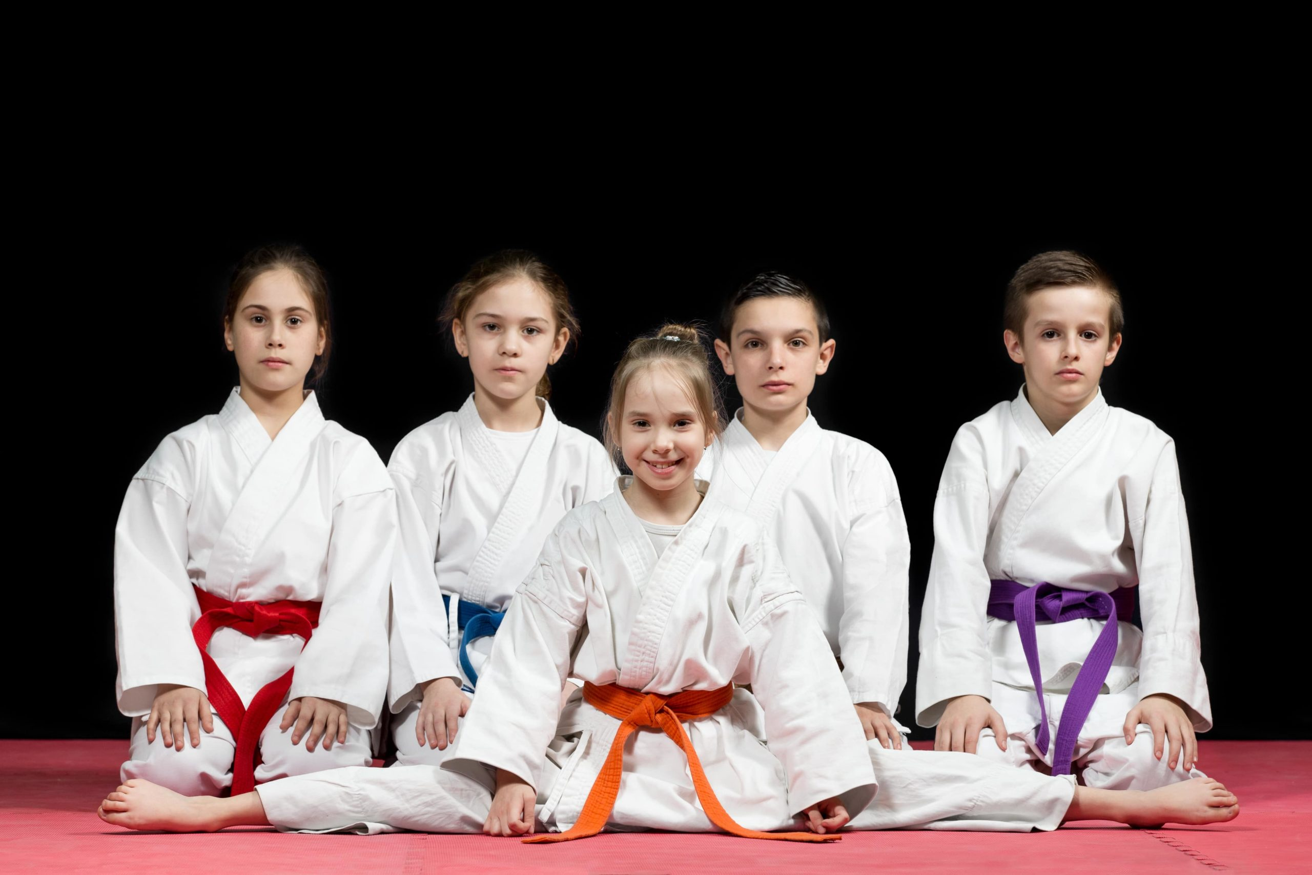 smiling kids in karate uniforms