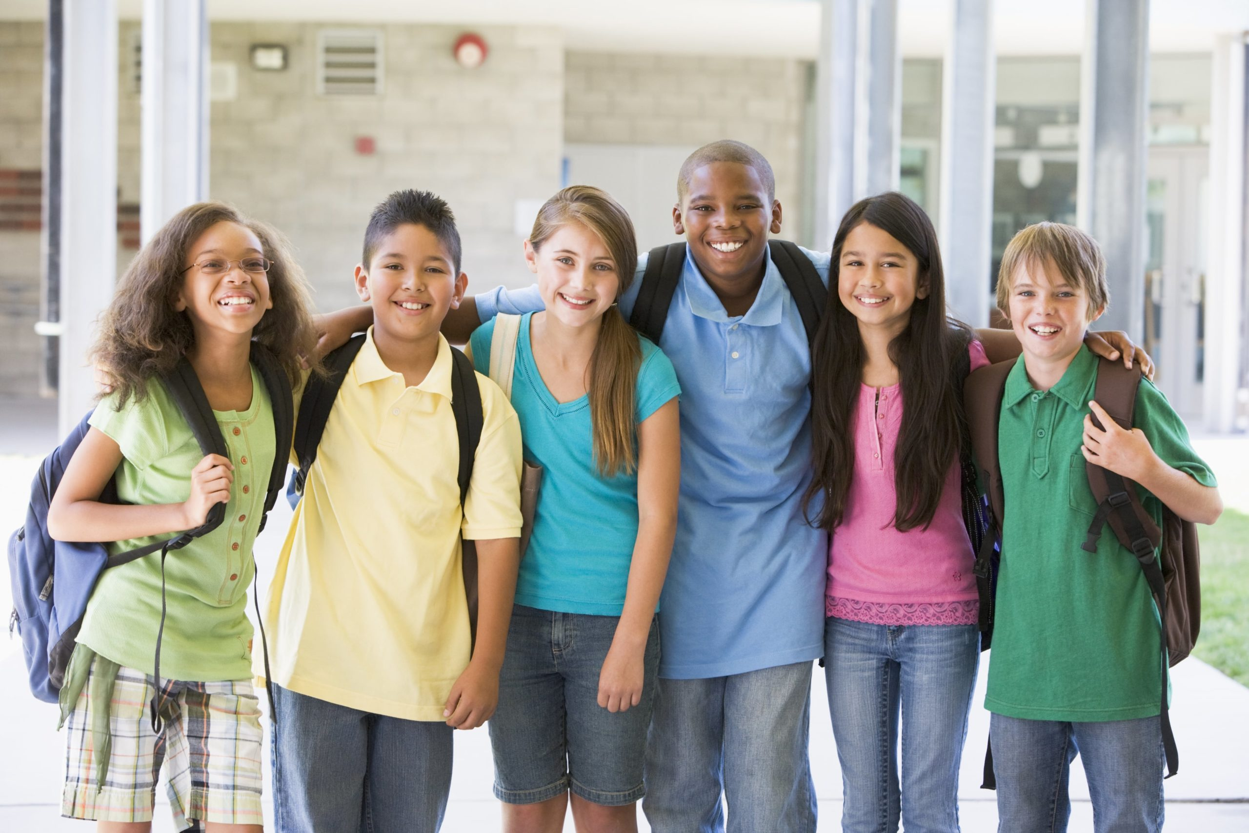 smiling diverse kids at school